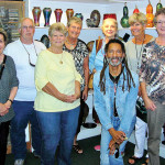 Study Group Leader John-Peter Wilhite (kneeling) along with Quail Creek/OLLI-UA Green Valley Campus Tucson Glass Art Scene class members and friends taking a moment at Tucson's Philabaum Glass Gallery and Studio.