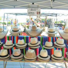 Palm straw cowboy hats and pachuco 50s style fedoras
