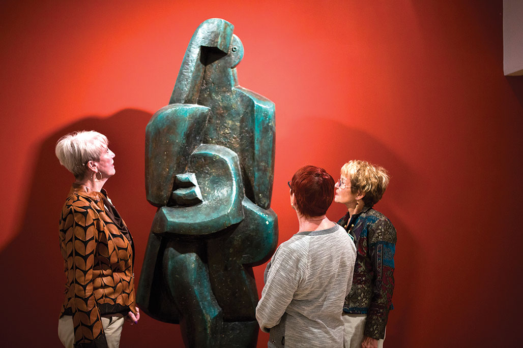 Theo Borden, Judith Cox and Bonnie Hyra admire the sculpture by Jacques Lipchitz at the UA Museum of Art.