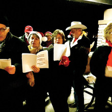 Carolers performing at the Grill.