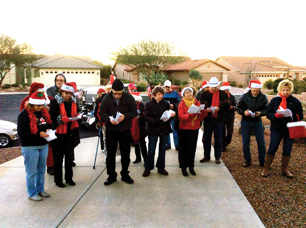 The caroling group singing at the first house.