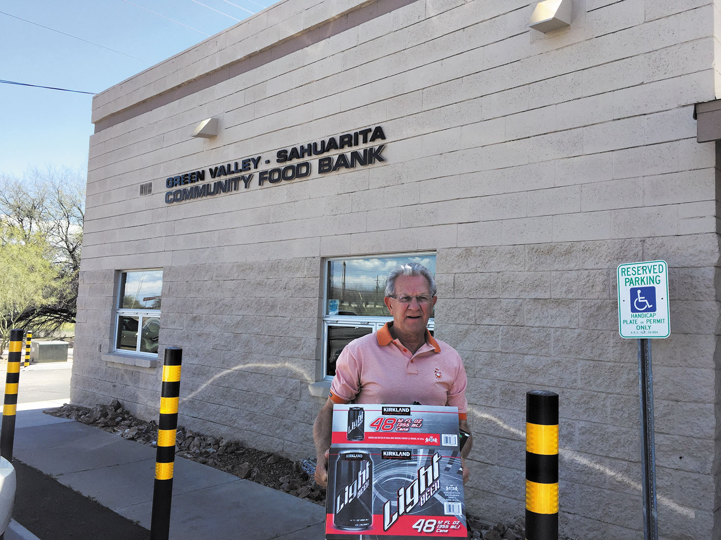 Harry Sawchuk proudly delivers part of the Canadian Club at Quail Creek donation to the Green Valley - Sahuarita Food Bank.