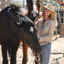 Guest speaker Karen Pomroy with two of the rescued horses at the Amado sanctuary of Equine Voices