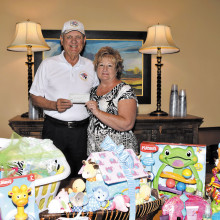 Ted Schelenski, Quail Creek Veterans Golf Association, presents a check for $500 to TWOQC Baby Shower Chair Pam Rodgers to help with the purchase of diapers and other baby necessities.