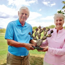 Tim Phillips, QCMGA Prickly Pair Tournament coordinator, with Bonnie Wilcox, representing the QCLGA, holding the about to be contested Prickly Pair Trophy.