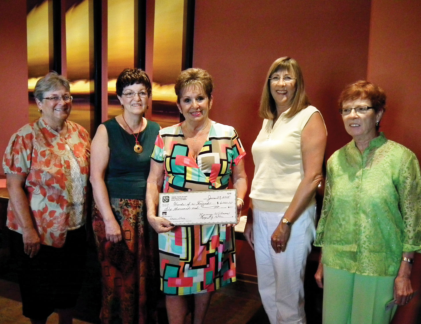 Cookbook Committee presents check to Genesis House Shelter. Left to right: Cindy Day, Committee Chair Claudia Ullevig, Genesis House Founder/CEO Patty O'Berry, Janice Swain and TWOQC President Peggy McGee. Photo by Lynda Rivard.
