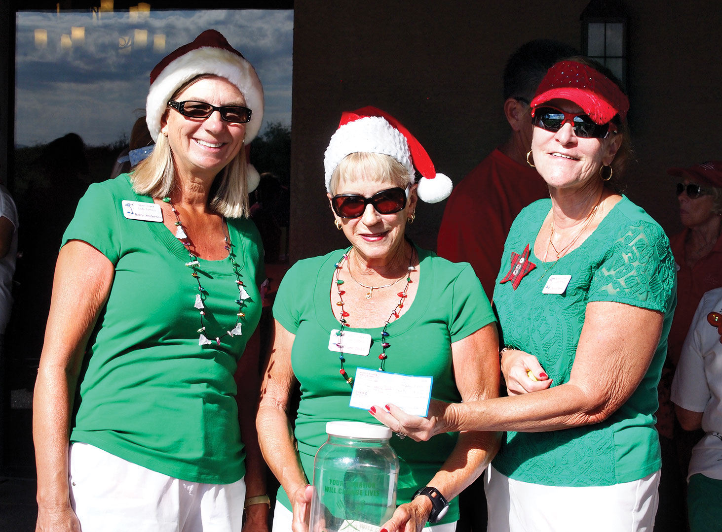 Left to right: Mary Anderson, Diane Dodd and Sylvia Perry took care of collecting cash and checks for the Christmas in July event; photo by Sylvia Butler.
