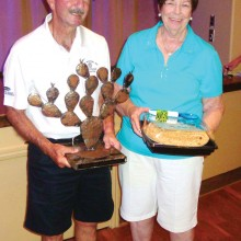 President Skip with Prickly Pair Trophy and Gail Phillips holds the Humble Pie