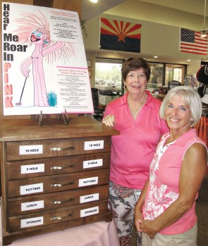 Gail Phillips and Cheri Sipe proudly show off the new Rally for the Cure Registration Chest of Drawers