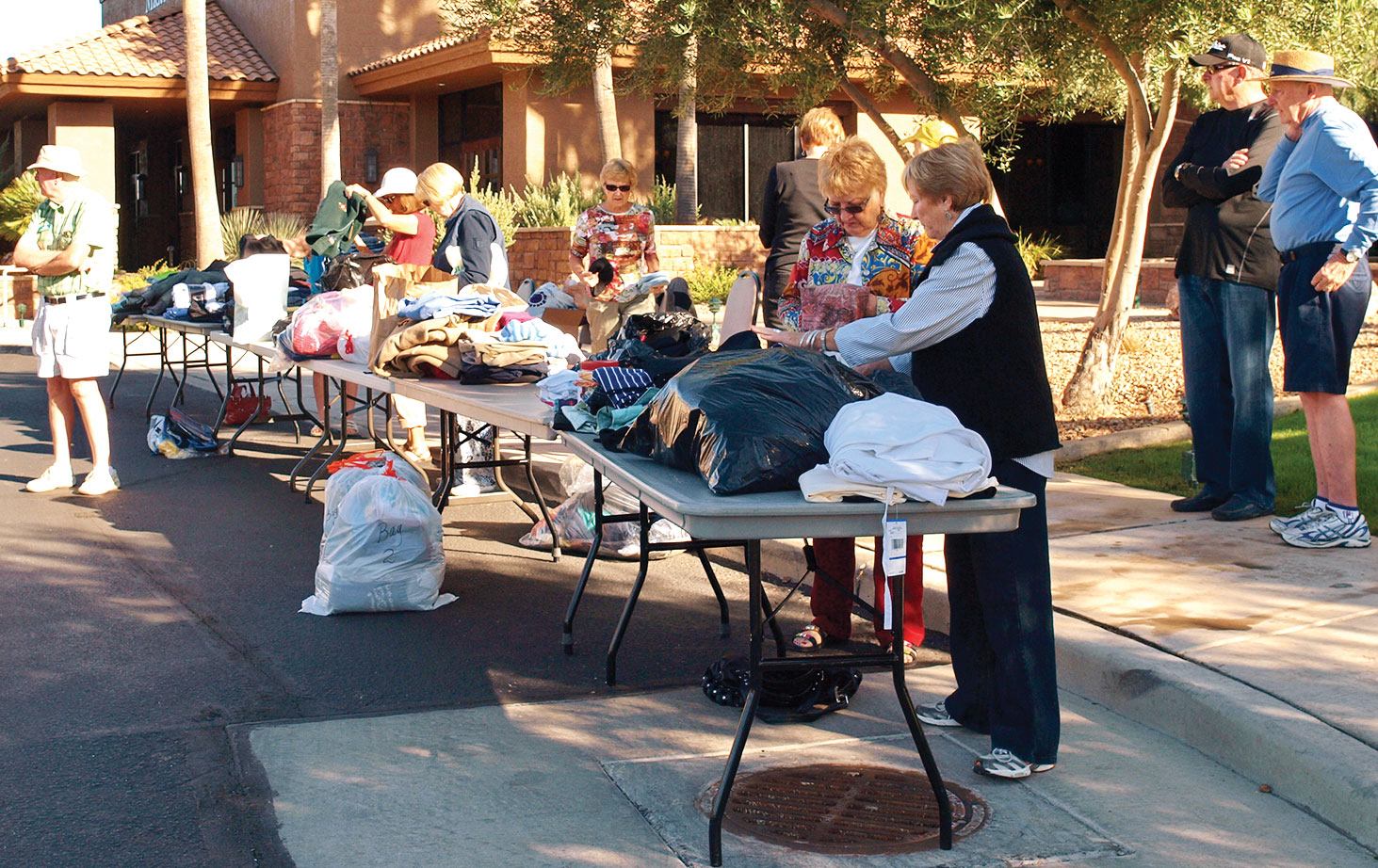 The Women of Quail Creek sort donations to benefit the homeless.
