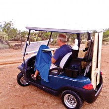 Jim Hall a la cart during a painting excursion into the desert July 31.