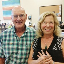 Cathy Hasson wearing her pendant, with Instructor Pete Irish