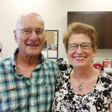Pete Irish with Sue Ann Obremski wearing her pendant