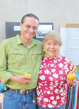 Josephina Lizarraga and Jesus Garcia serving pomegranates