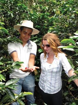 Anna Perreira inspects the coffee crop with Lorving Calderon at Mi Tazita Coffee Farm in Honduras.