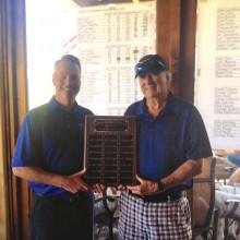 Quail Creek Men's Golf Association 2015 Super Senior Champion Brian Kuehn receives his trophy from Head Golf Professional Joel Jaress after winning the First Super Senior Championship.
