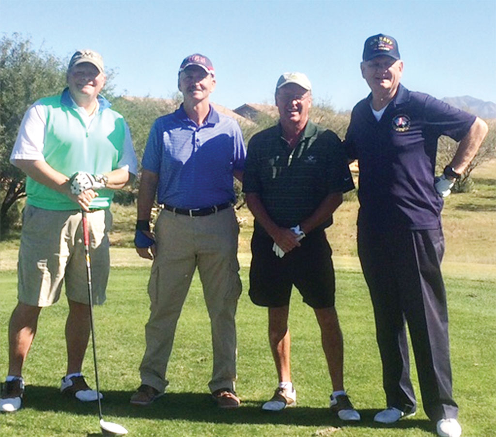 Golfers Bob Morgan, Randy Mathis, Randy Davis and Ted Schelenski take top honors at Veterans Day Charity Tournament.