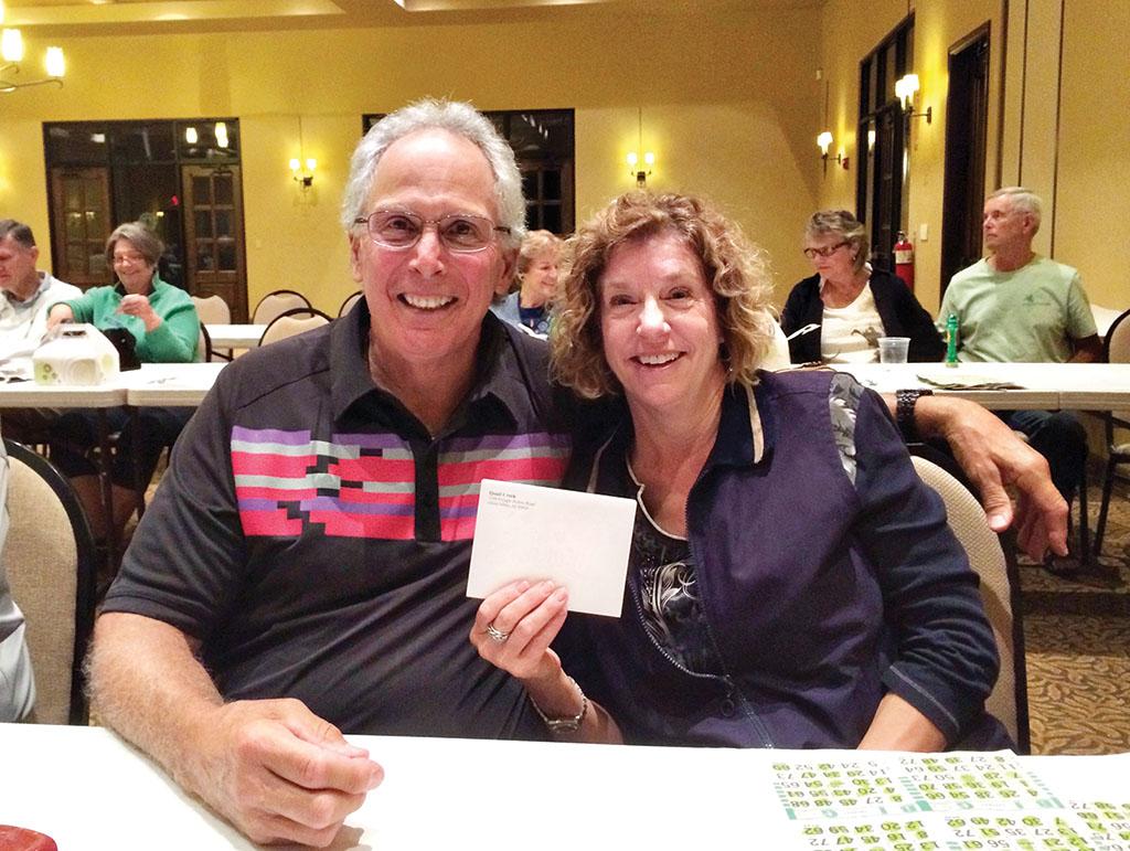 Green Committee Chair Ralph Scafuri and former Finance Committee member Paula Scafuri celebrate Paula's big win at the November 13 Volunteer Appreciation event.