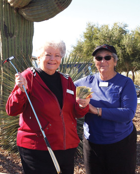 Left to right: Dorene Sims received $5 from Putters Treasurer Gloria Clancy for her hole-in-one. She was the only Lady Putter to accomplish that feat on Putt with the Pro day; photo by Sylvia Butler
