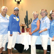Left to right: Sporting daisies in their hair, Planning Committee members Jan Agner, Mary Anderson, Diane Dodd, Deb Anderson and Kelly Hines decorated tables with cacti and daisies; photo by Greg Freeland.