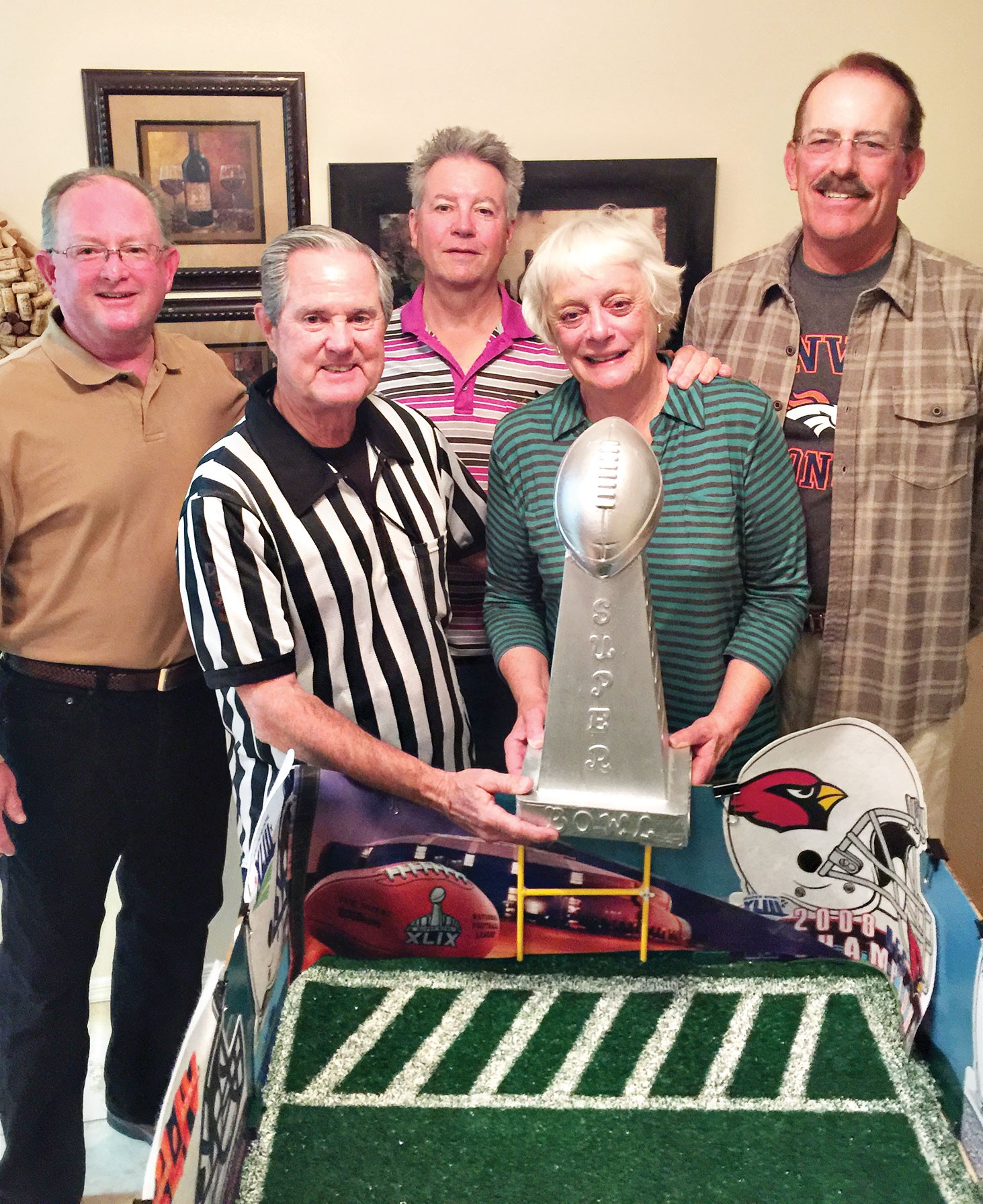 Back row, left to right: Frank Baker, Denny Huber and Rick Kimes; front, Lance Manning and Linda Matsen