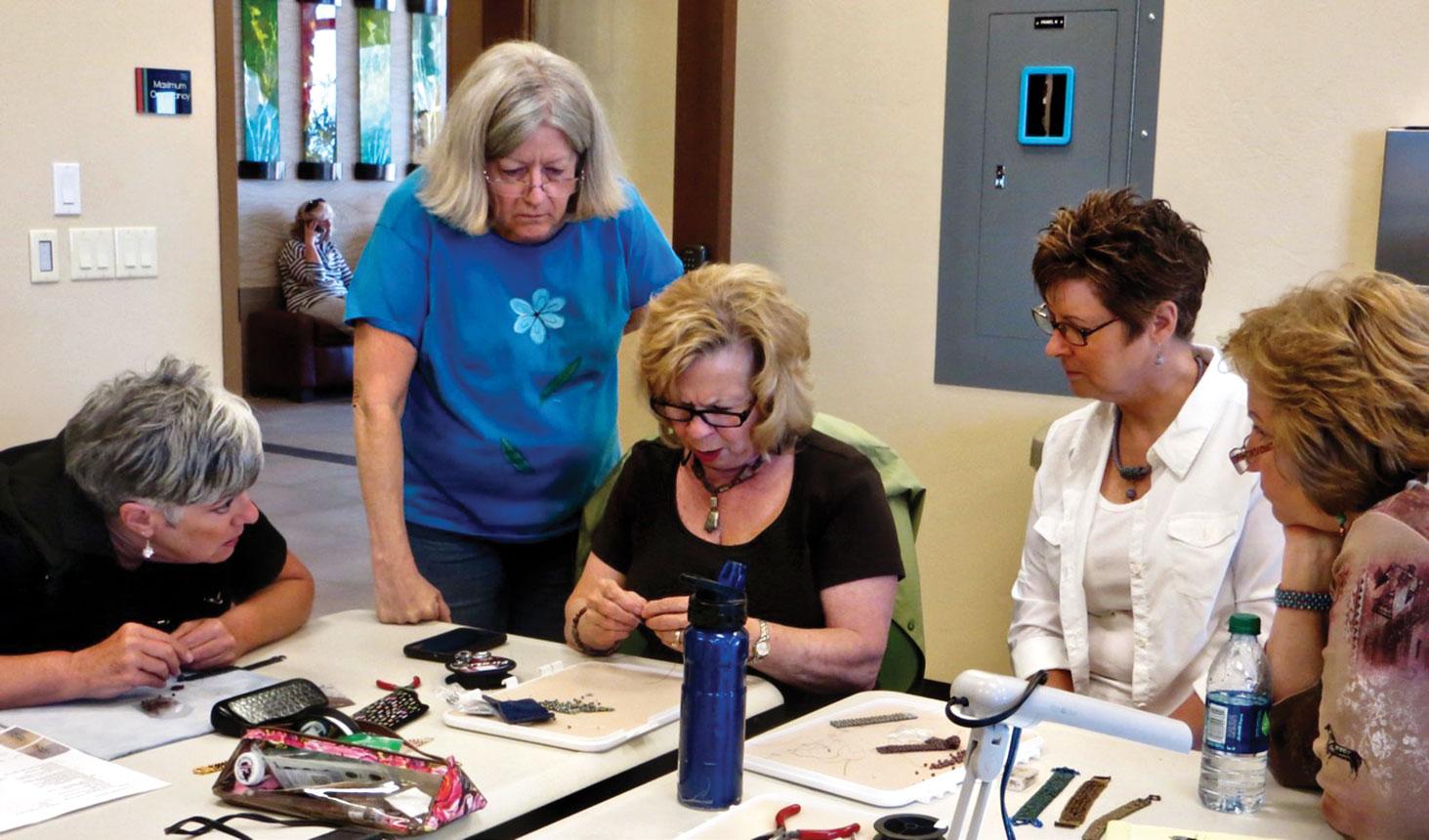 Frannie Vanselow, Marcia Faulkner, Cathy Hasson (demonstrating beading pattern), Darlene Pope, Kathie Kidwell