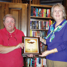 New Library Co-chair Dawn Bangs (left) presenting Certificate of Appreciation for over ten years of service to Ginny Post