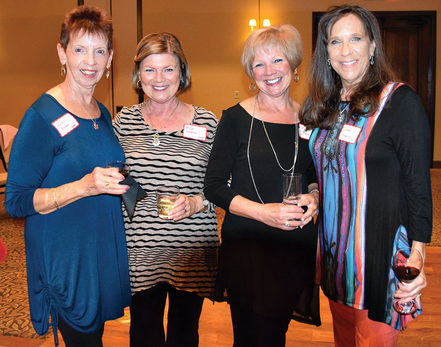 Enjoying the February 9 Minnesota Club dinner at the Madera Clubhouse are Kathy Gauger, Merri Henderson, Karen Morgan and Cynthia Rosenlund.