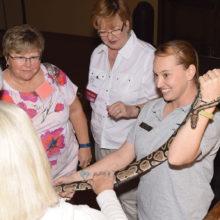 Dani Farrington introduces a python to members; photo by Eileen Sykora