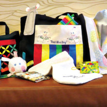 A sample of the numerous baby and mom items that are being made by SueAnn Obremski.