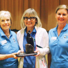 Left to right: Lou Moultrie is presented a plaque for achieving the lowest score from former Putters President Dee Waggoner and Kelly Hines, vice president; photo by Sylvia Butler.