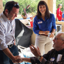 CD2 candidate Victoria Steele and Pima County Attorney candidate Joel Fineman chat with guest Phil Katz (seated).