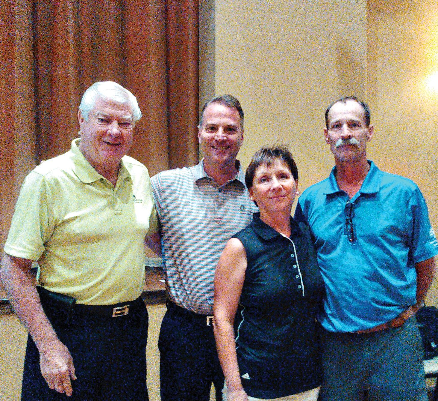 Left to right: Dick Kohlman, president of QCCGA, Joel Jaress, club professional QC, Christie Greiter club champion and Dave Chambers club champion