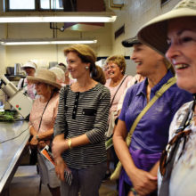 Women are treated to a view of the preparation of nearly 200 individualized meals for zoo inhabitants.