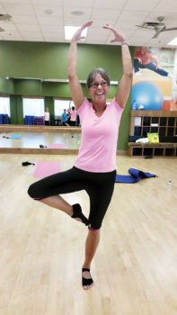 Instructor Aprylmarie Heule demonstrates a pose designed to improve balance during her stretching class; photo by Mary Hassler