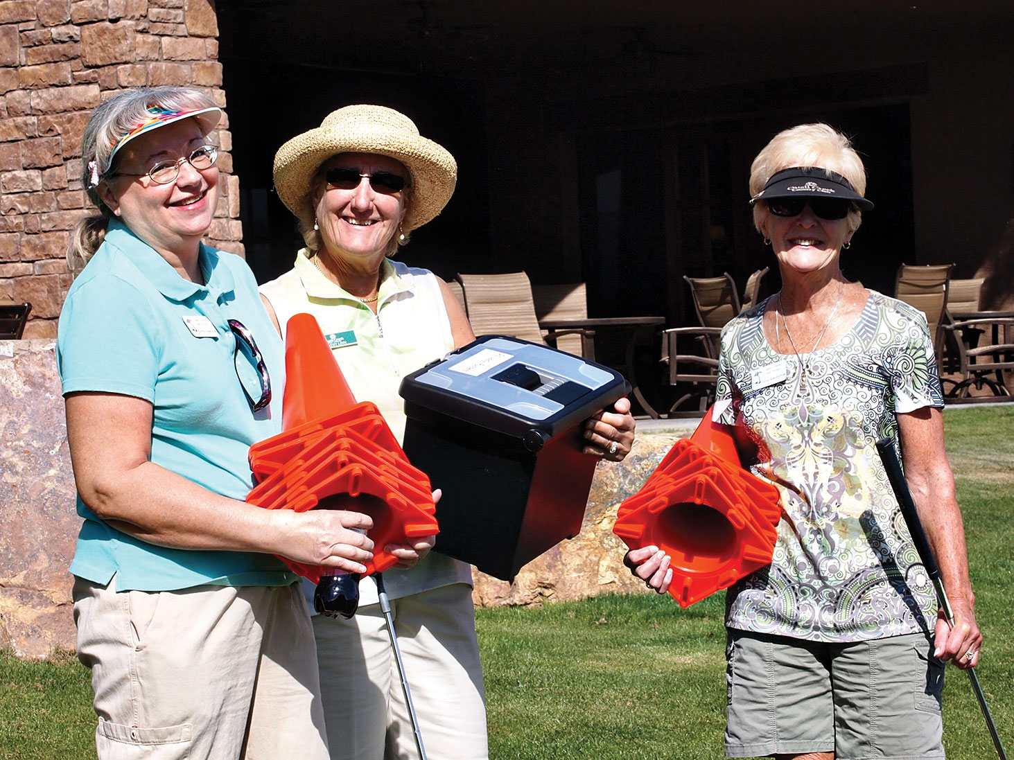 Left to right: The set-up team Kathy Hamilton, Kathy Linn and Terry Ramsbottom gather the supplies needed to set up the course to make it challenging and safe; photo by Sylvia Butler.