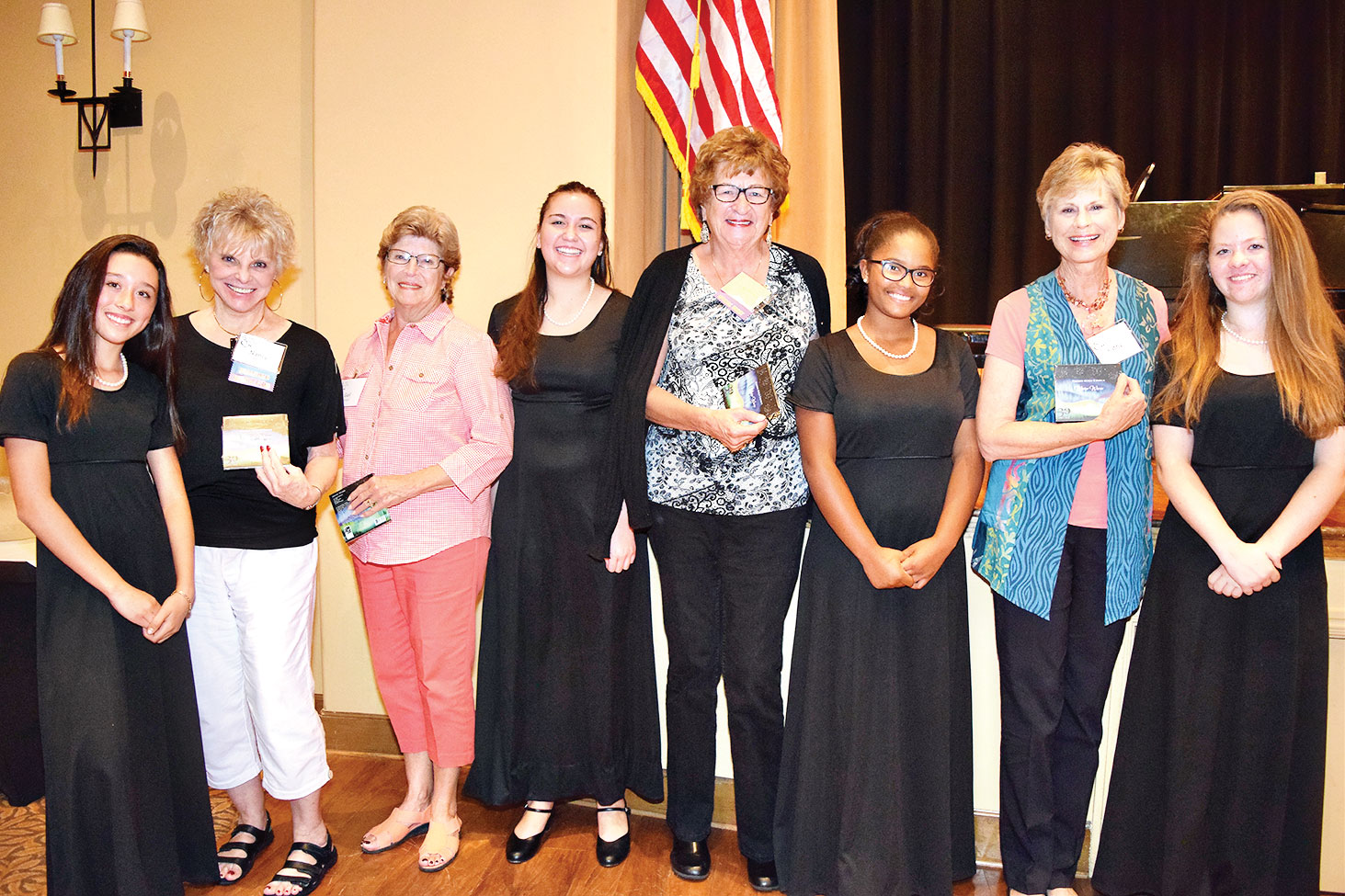 Members of the choir presented door prizes to lucky members of TWOQC.