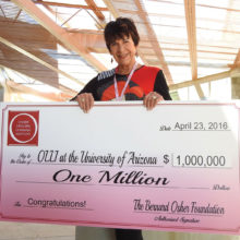 "Dr. Jana Eaton of Quail Creek accepts a million dollar endowment check from the Bernard Osher Foundation on behalf of the 1,200-member Osher Lifelong Learning Institute-University of Arizona. Eaton is president of the board of directors for OLLI-UA which maintains a ""cooperative and symbiotic relationship"" with the Quail Creek Education Committee and holds classes in Quail Creek as well as PCC and the Casa Community Center in Green Valley. OLLI Board Vice President Lois Connell (not pictured) is also a Quail Creek resident. There are over 500 OLLI members in the Green Valley area including almost 200 Quail Creek residents; photo courtesy of Ed Freedman."