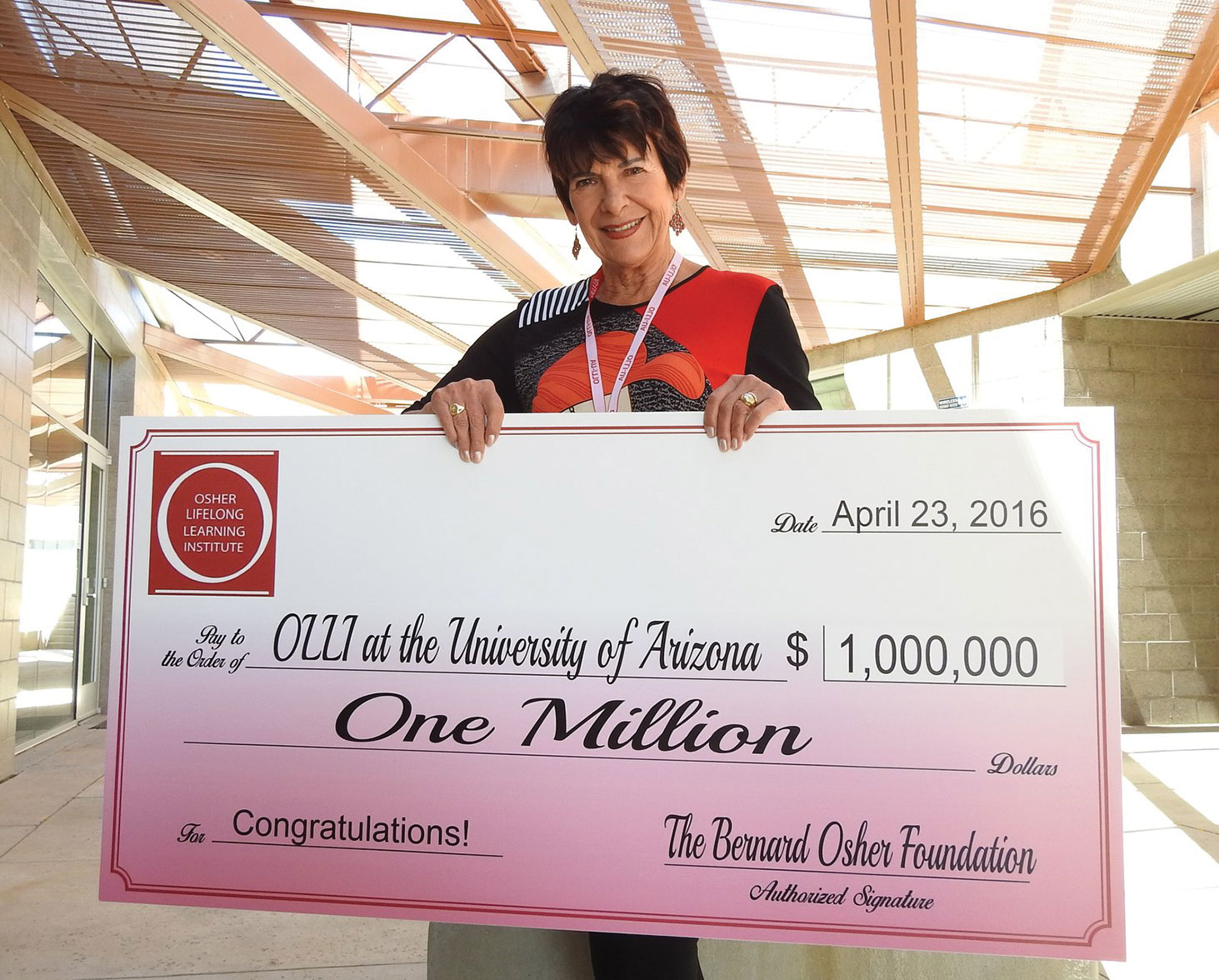 """Dr. Jana Eaton of Quail Creek accepts a million dollar endowment check from the Bernard Osher Foundation on behalf of the 1,200-member Osher Lifelong Learning Institute-University of Arizona. Eaton is president of the board of directors for OLLI-UA which maintains a """"cooperative and symbiotic relationship"""" with the Quail Creek Education Committee and holds classes in Quail Creek as well as PCC and the Casa Community Center in Green Valley. OLLI Board Vice President Lois Connell (not pictured) is also a Quail Creek resident. There are over 500 OLLI members in the Green Valley area including almost 200 Quail Creek residents; photo courtesy of Ed Freedman."""