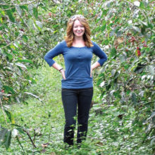 Anna Perreira in the midst of coffee plants at La Merced farm in Guatemala