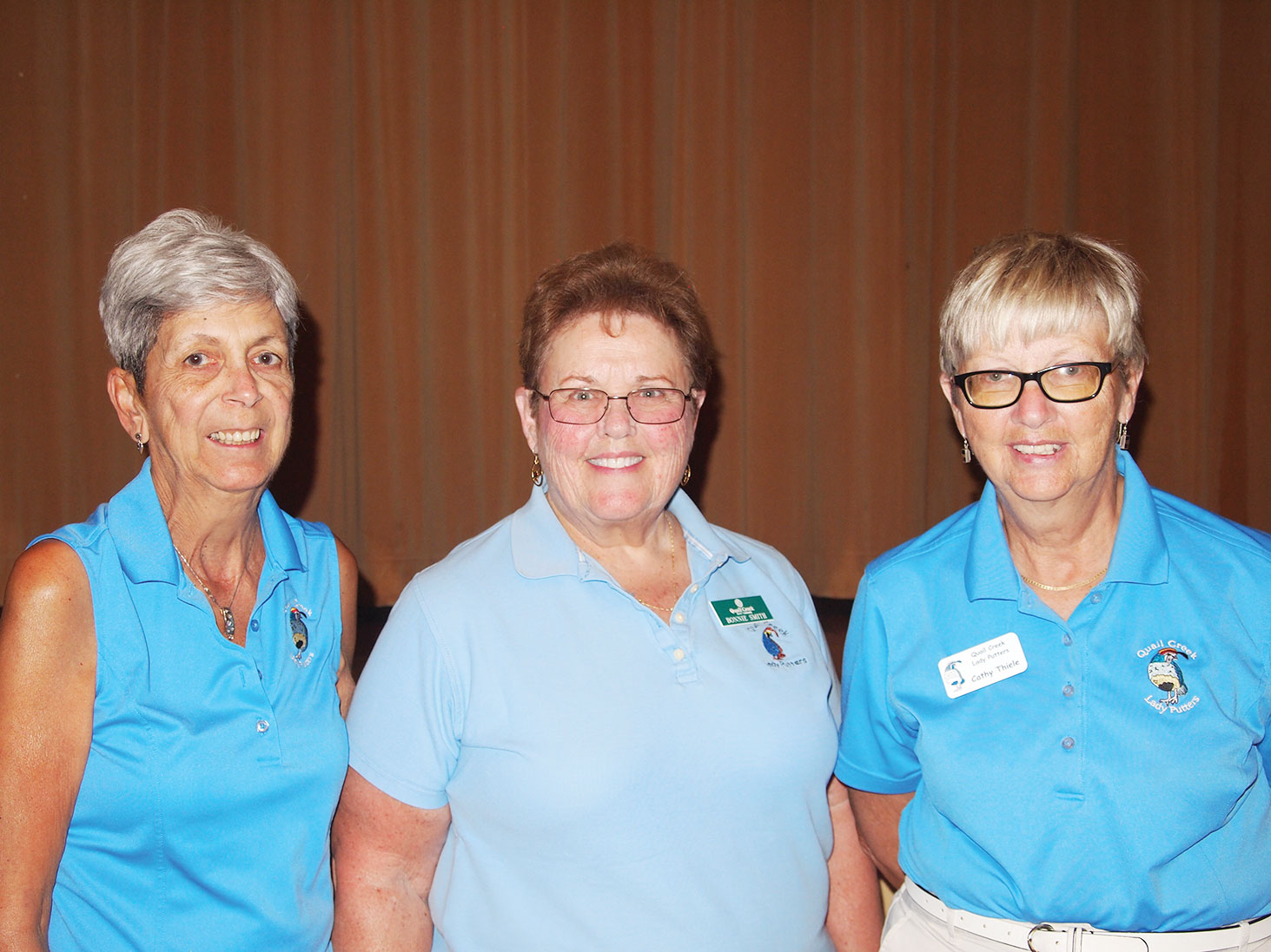 Left to right: Sheila Wyllie and Bonnie Smith did not share their $5 money hole winnings with Putters President Cathy Thiele; photo by Sylvia Butler.