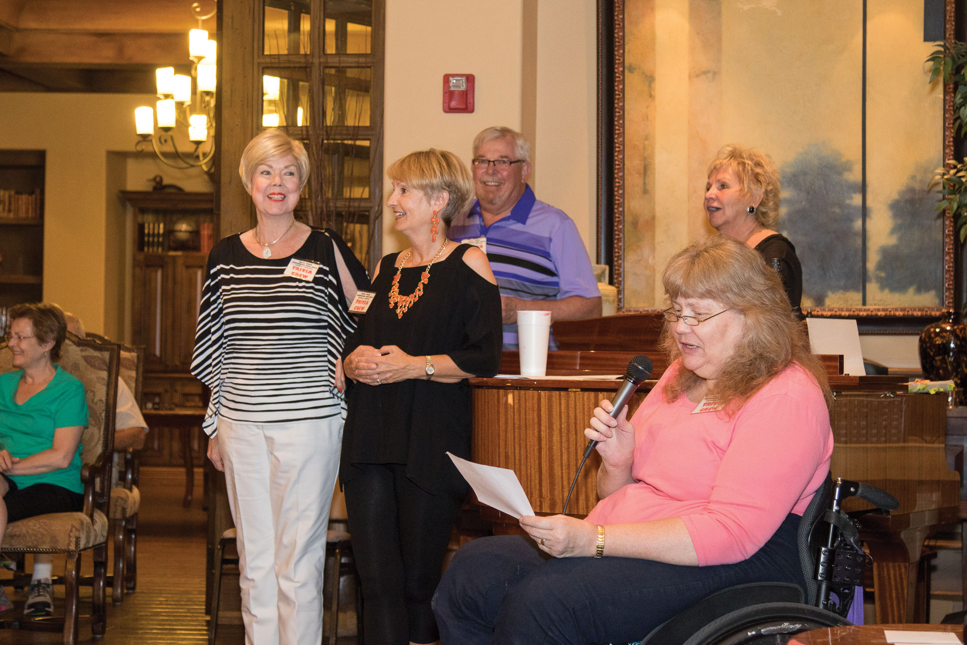 Trivia Crew, left to right: Joyce Walton, Pam Campbell, Bruce Ranney, Cyndy Gierada, Donna Smith (with microphone); photo by Jeff Krueger