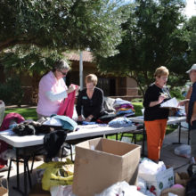 Volunteers from TWOQC gather at the Madera Clubhouse to collect, sort and bag the thousands of donated items.