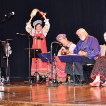 Members of the Arizona Balalaika Orchestra joyfully performing for TWOQC; photo by Eileen Sykora