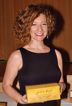 Anna Perreira with the signature Yellow Brick Coffee brick box sampler; Photo by Eileen Sykora