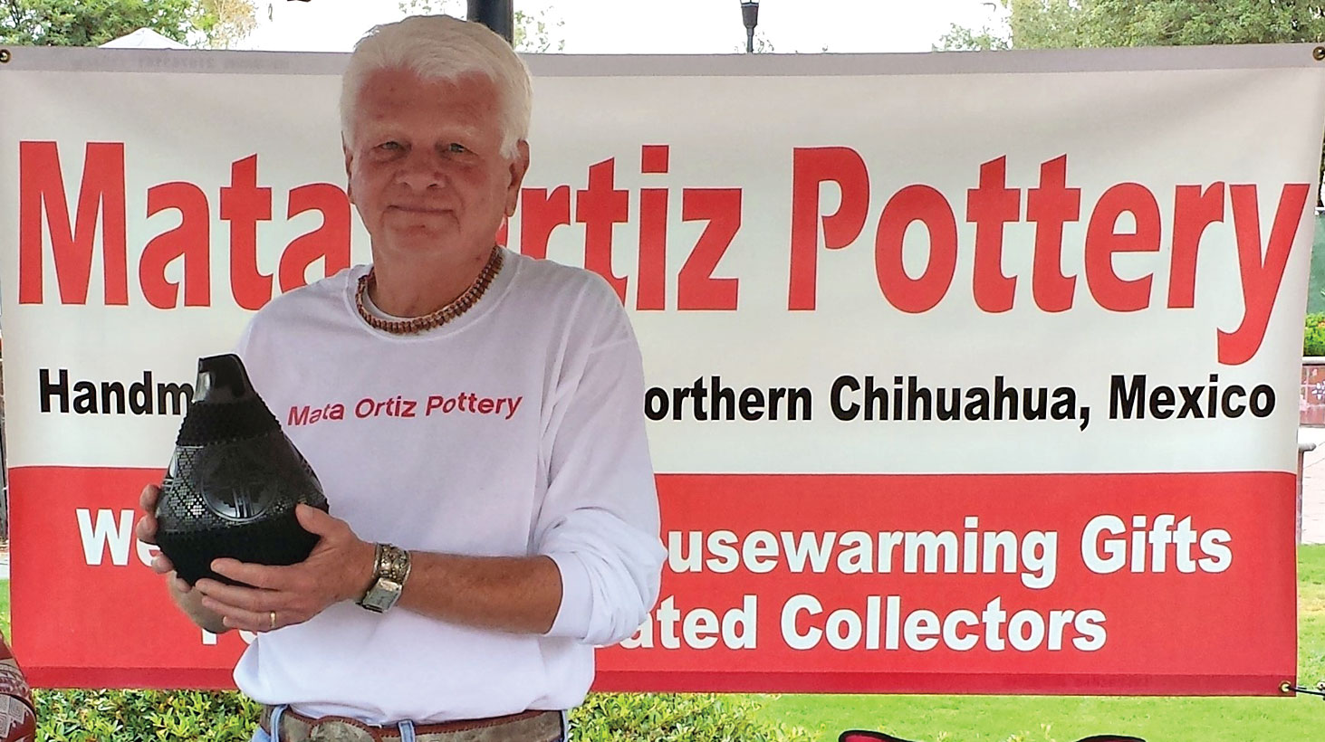 Ron Sullivan displays a Mata Ortiz vessel.