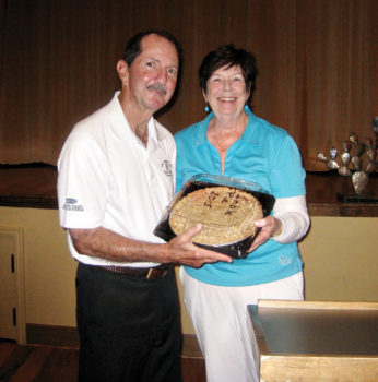 President Skip Fumia receives the Humble Pie from President Gail