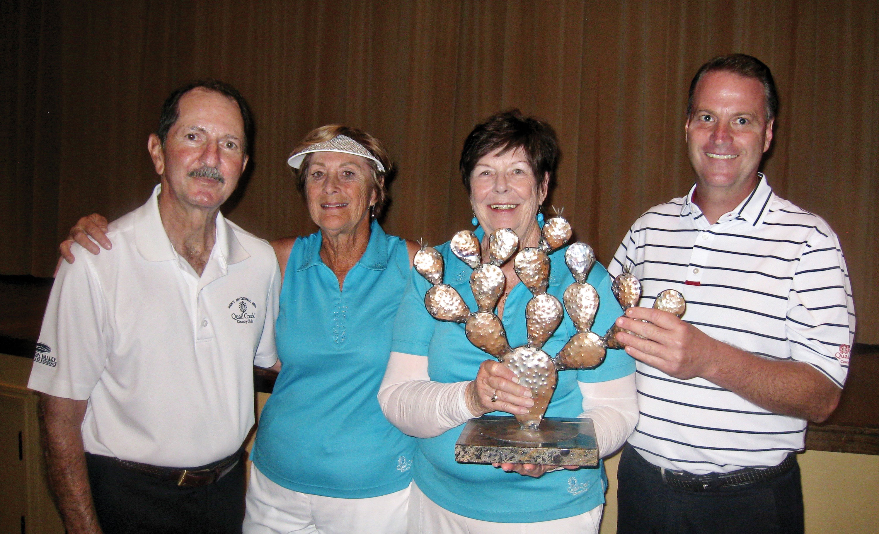 Skip Fumia, Carol Clifford, Gail Phillips and Joel Jaress with the traveling Prickly Pair trophy