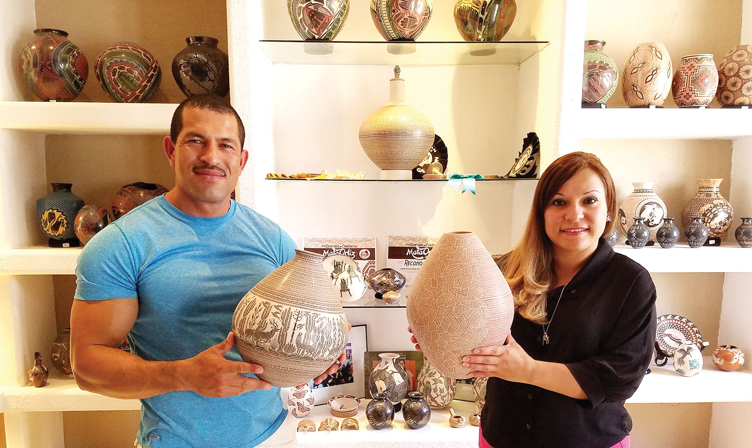 Hector Gallegos, Jr. and Laura Bugarini Cota in their Mata Ortiz home; photo by Ron Sullivan.