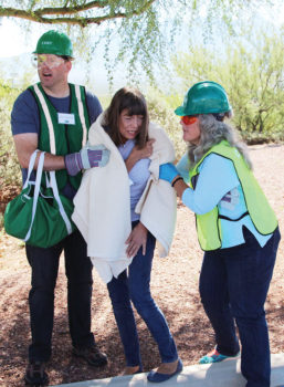 Quail Creek resident, Susan Allen, (far right) and another CERT student, David Mayberry assist victim Pam Kulbarsh during disaster exercise; photo by John McGee.